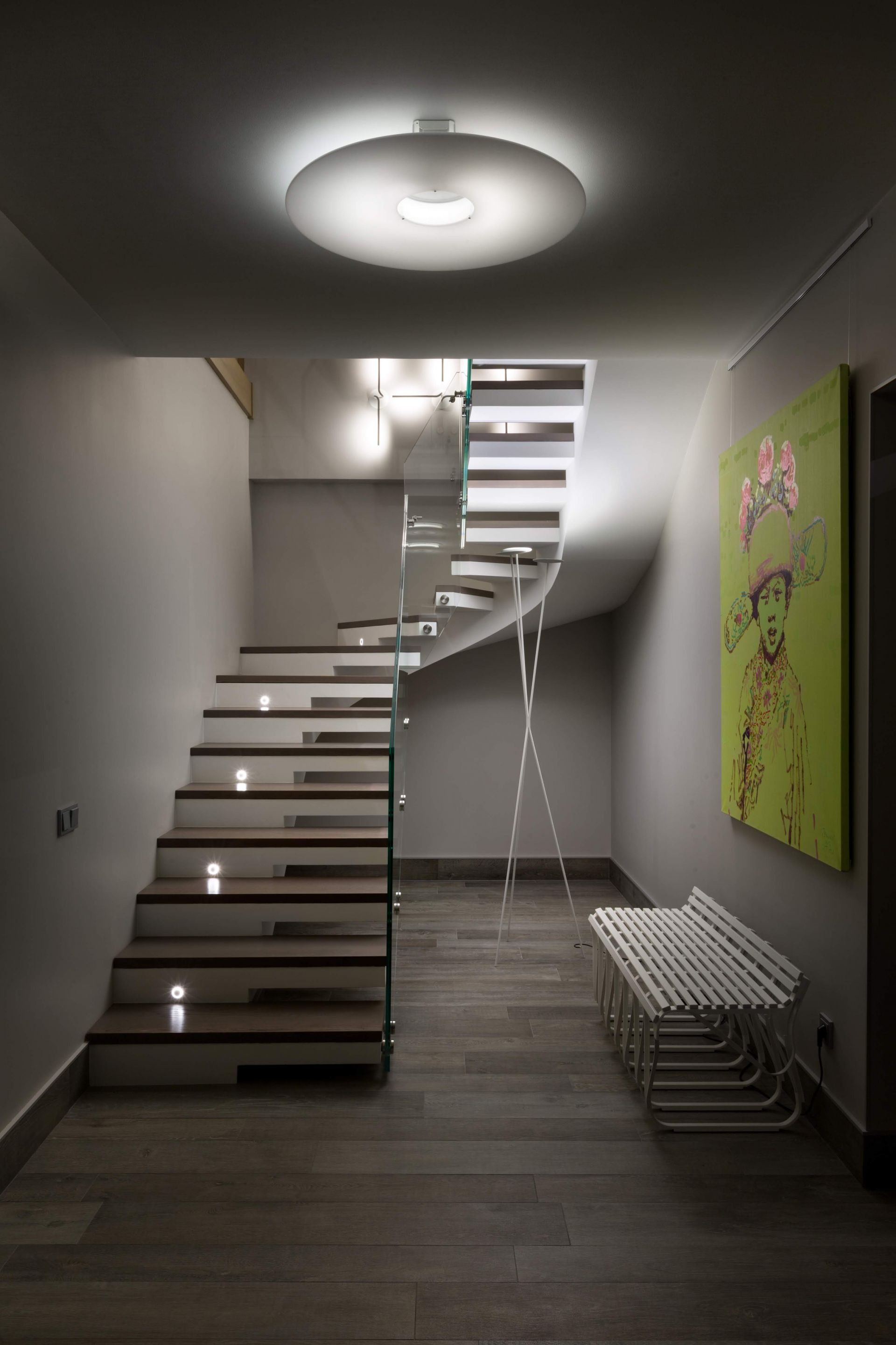 Staircase with glass railing